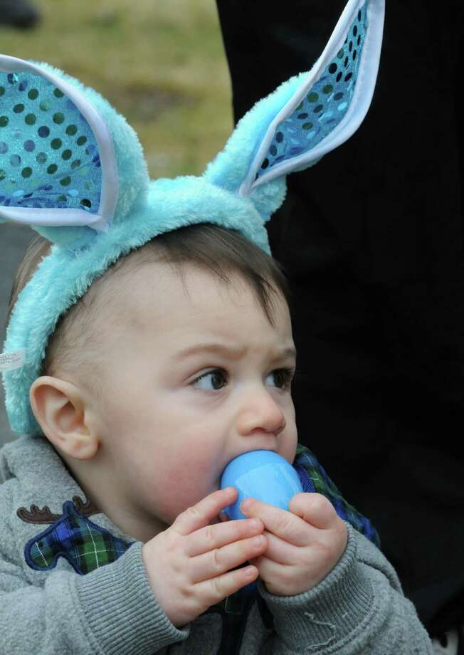 Eight-month-old James Smith of Cohoes takes part in the St. John's Episcopal Church easter egg hunt on Saturday March 26, 2016 in Cohoes, N.Y. (Michael P. Farrell/Times Union) Photo: Michael P. Farrell / 10035857A