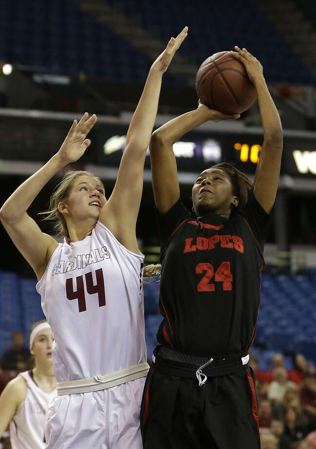 Antelope Valley's Oriana Brown, left, goes up for the shot against Cardinal Newman's Lauren Walker during the second half of the CIF girl's Division IV high school basketball championship game Saturday, March 26, 2016, in Sacramento, Calif. Cardinal Newman won 39-37. (AP Photo/Rich Pedroncelli) Photo: Rich Pedroncelli, AP