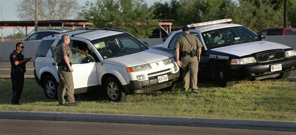 A Palmview Police officer, left, assists Texas State Troopers with a traffic violation stop on I-2 in Palmview, TX on Thursday, March 24, 2016. DPS is making their presence known in the Rio Grande Valley.