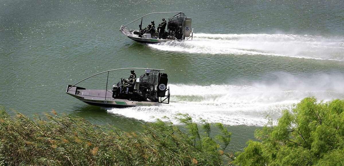 Two Border Patrol boats patrol the Rio Grande River at Roma, TX on Thursday, March 24, 2016.