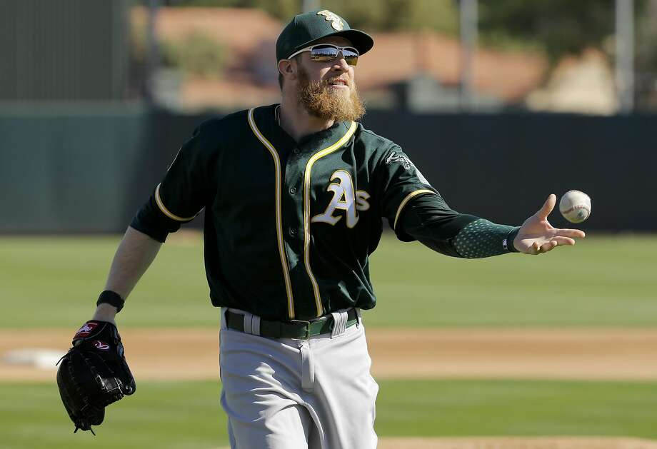 Oakland Athletics relief pitcher Sean Doolittle fields a ball during spring baseball practice in Mesa, Ariz., Thursday, Feb. 25, 2016. (AP Photo/Chris Carlson) Photo: Chris Carlson, AP