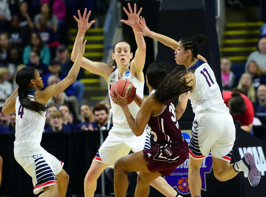 UConn's Moriah Jefferson, left, Breanna Stewart and Kia Nurse, right, surround Mississippi State's Victoria Vivians during NCAA Division I Women's Basketball Championship action at the Arena at Horbor Yard in Bridgeport, Conn., on Saturday March 26, 2016. Photo: Christian Abraham, Hearst Connecticut Media