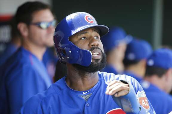 Chicago Cubs' Jason Heyward celebrates after scoring against the Cincinnati Reds during a spring training baseball game Tuesday, March 22, 2016, in Goodyear, Ariz. (AP Photo/Jae C. Hong)