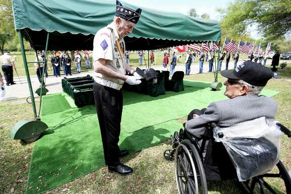 Korean War veterans Lee Henderson, left, and George Click talk before the funeral for Cpl. Davey Bart, a Korean POW whose bones were recently identified 65 years after his death on Saturday, March 26, 2016, in Humble.