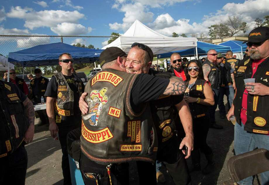 Jeff Pike, former Bandidos Motorcycle Club president, center-right, was greeted by members at the group's 50th anniversary party March 12 in Kingwood.
