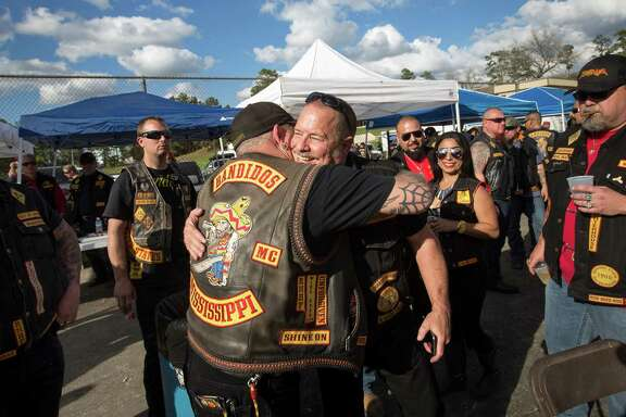 Jeff Pike, former Bandidos Motorcycle Club president, center-right, was greeted by members at the group's 50th anniversary party March 12 in Kingwood.  ( Jon Shapley / Houston Chronicle )