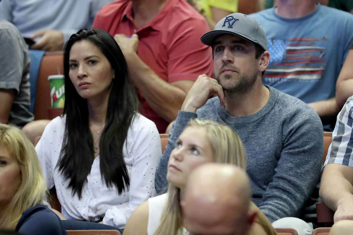 ANAHEIM, CA - MARCH 26: Actress Olivia Munn and Aaron Rodgers of the Green Bay Packers watch the NCAA Men's Basketball Tournament West Regional Final at Honda Center on March 26, 2016 in Anaheim, California.