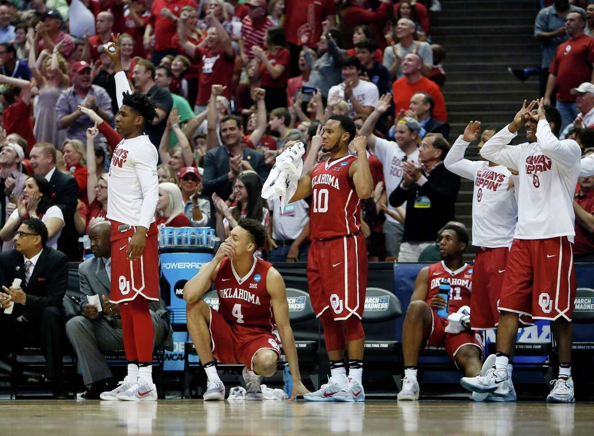 The Oklahoma bench celebrates during the second half of an NCAA college basketball game against Oregon in the regional finals of the NCAA Tournament, Saturday, March 26, 2016, in Anaheim, Calif.