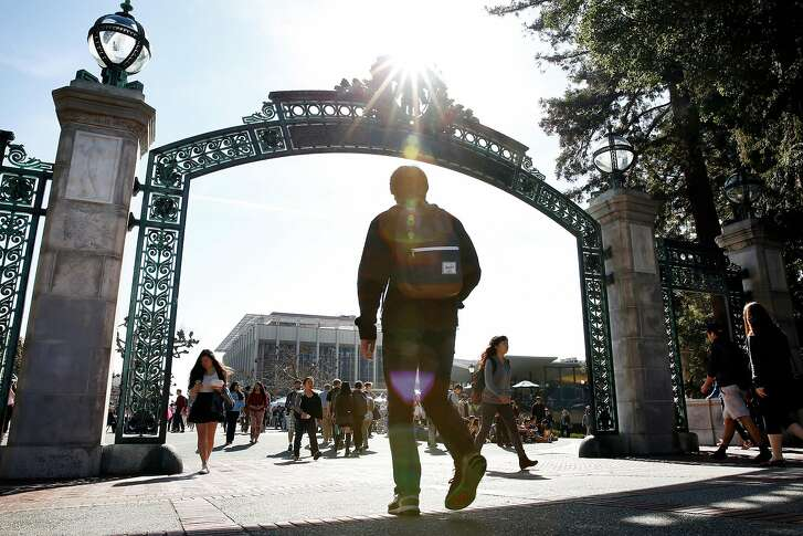 Students pass through Sather Gate on the Cal campus in Berkeley, CA Wednesday, February 11, 2016.