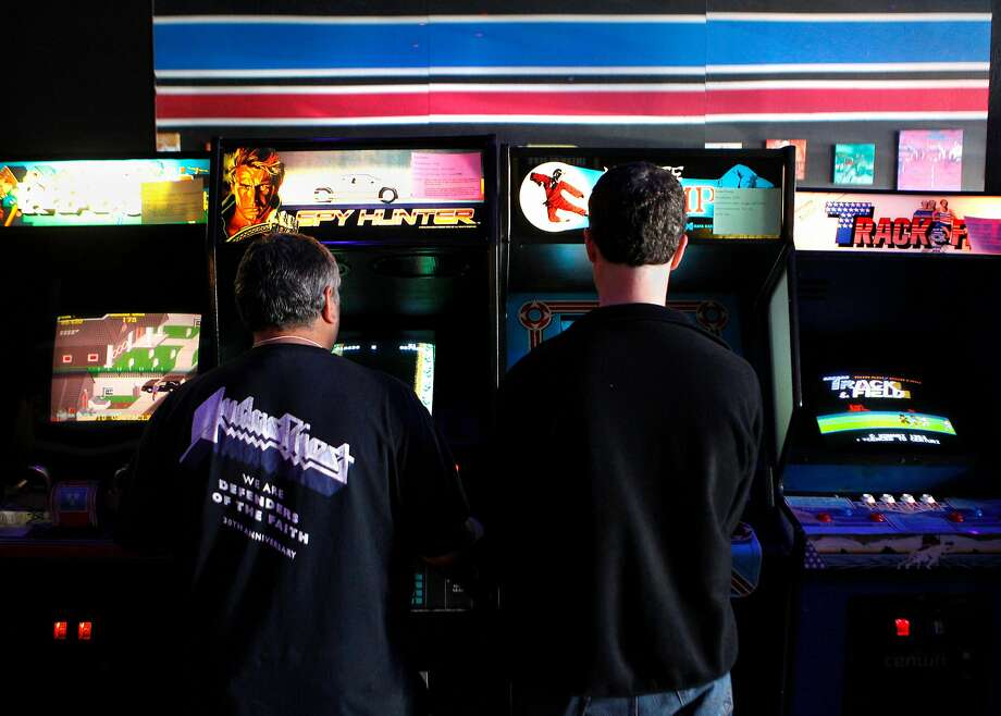 Competitors in the 2016 Classic Arcade Gaming (dot com) Tournament play for top scores on classic games such as Spy Hunter and Karate Champ at High Scores, the interactive arcade museum in Alameda, Calif., on Saturday March 26, 2016. Photo: Brittany Murphy / The Chronicle 2016