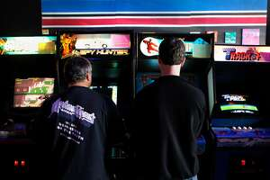 Competitors in the 2016 Classic Arcade Gaming (dot com) Tournament play for top scores on classic games such as Spy Hunter and Karate Champ at High Scores, the interactive arcade museum in Alameda, Calif., on Saturday March 26, 2016.