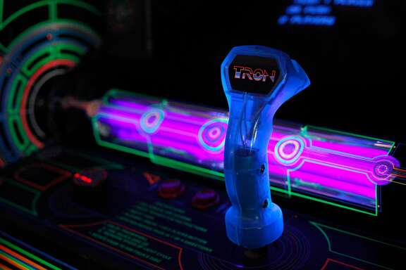 Tron is one of the over 45 games that are available to play at High Scores, the interactive arcade museum in Alameda, Calif., on Saturday March 26, 2016.