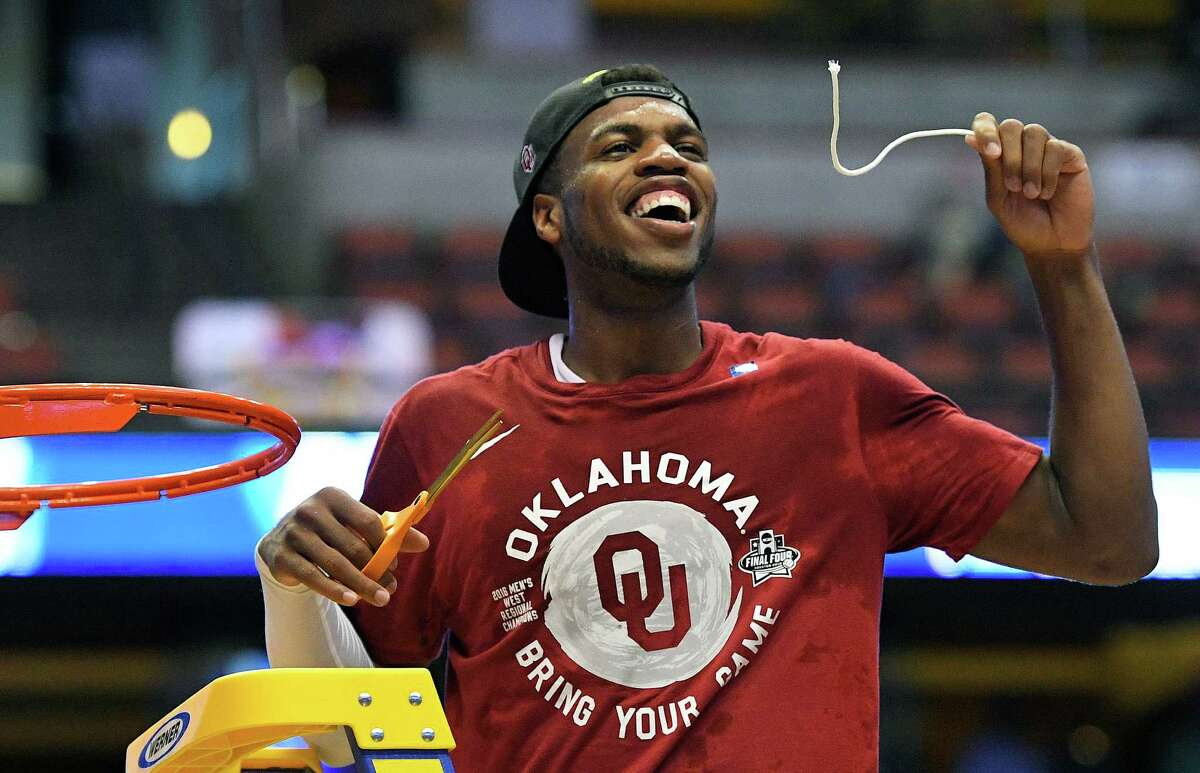 Oklahoma guard Buddy Hield cuts down the net after their win against Oregon during an NCAA college basketball game in the regional finals of the NCAA Tournament, Saturday, March 26, 2016, in Anaheim, Calif.