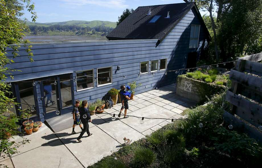 The view, far left, from the back deck of the Inverness home of Whitman Shenk and Lazuli Whitt. Photo: Michael Macor, The Chronicle