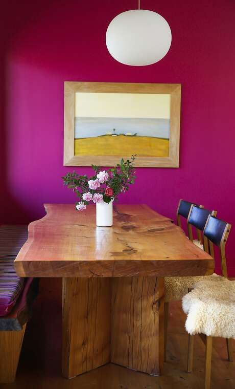 The dining table was made from a Cypress tree that grew on the property at the home of Whitman Shenk and Lazuli Whitt. Photo: Michael Macor, The Chronicle