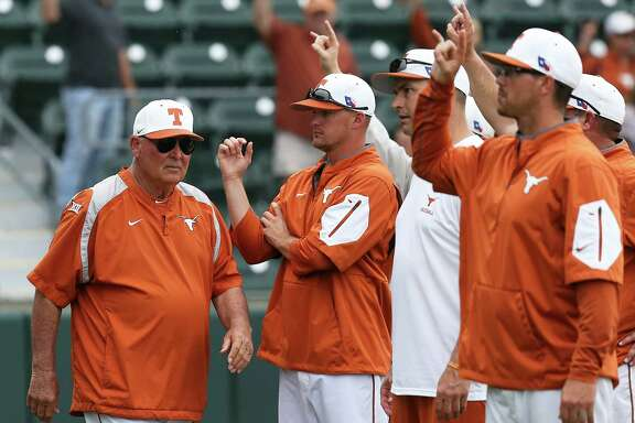 Augie Garrido walks near his coaches as Texas loses to TCU 9-5 in college baseball at Disch-Falk Field on March 26, 2016, in Austin.