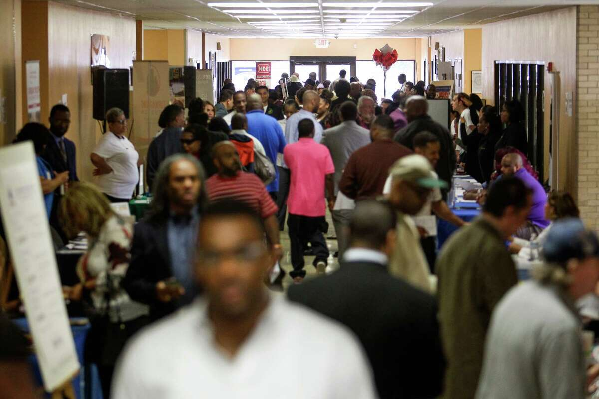 Hundreds of people show up at a Turnaround Houston event as they hold a combination of a job and resource fair at the Sunnyside Multi-Services Center for prior offenders seeking employment Saturday, March 26, 2016 in Houston. NEXT: Tough questions on job interviews.