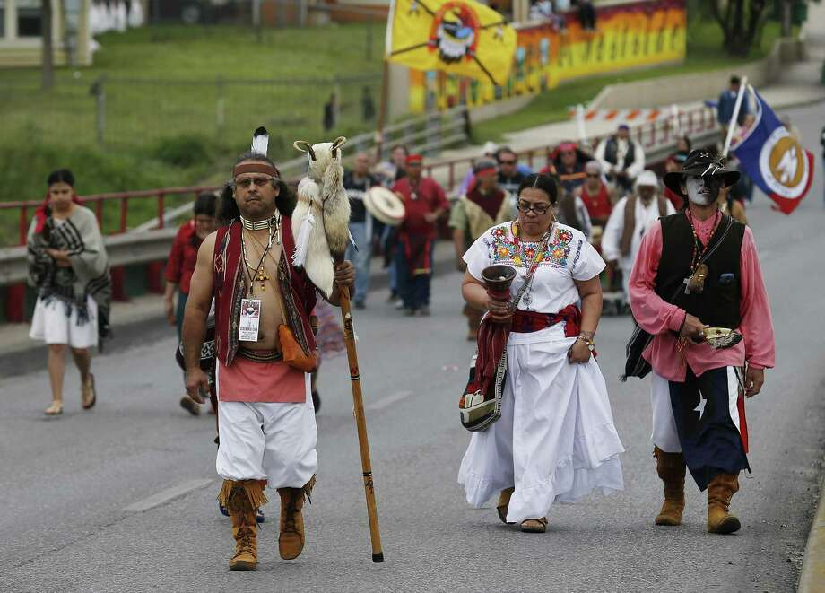 Moncies Garcia Hernandez (walking in front) of the Lipan Apache tribe of Texas from Alice, Texas, leads the 20th March for Justice by the Cesar E. Chavez Legacy and Educational Foundation on March. 26, 2016. Several other indigenous tribes joined Hernandez in the march. Hundreds took part in the march honoring the late labor leader, Chavez, who co-founded the National Farm Workers Association with Dolores Huerta in the 1960s. Photo: Kin Man Hui /San Antonio Express-News / ©2016 San Antonio Express-News