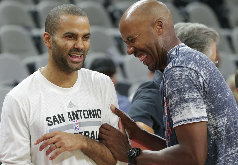 Tony Parker and Bruce Bowen joke around during the pregame shootaround as the Spurs host the Phoenix Suns at the AT&T Center on Oct. 20, 2015. Photo: Tom Reel /San Antonio Express-News