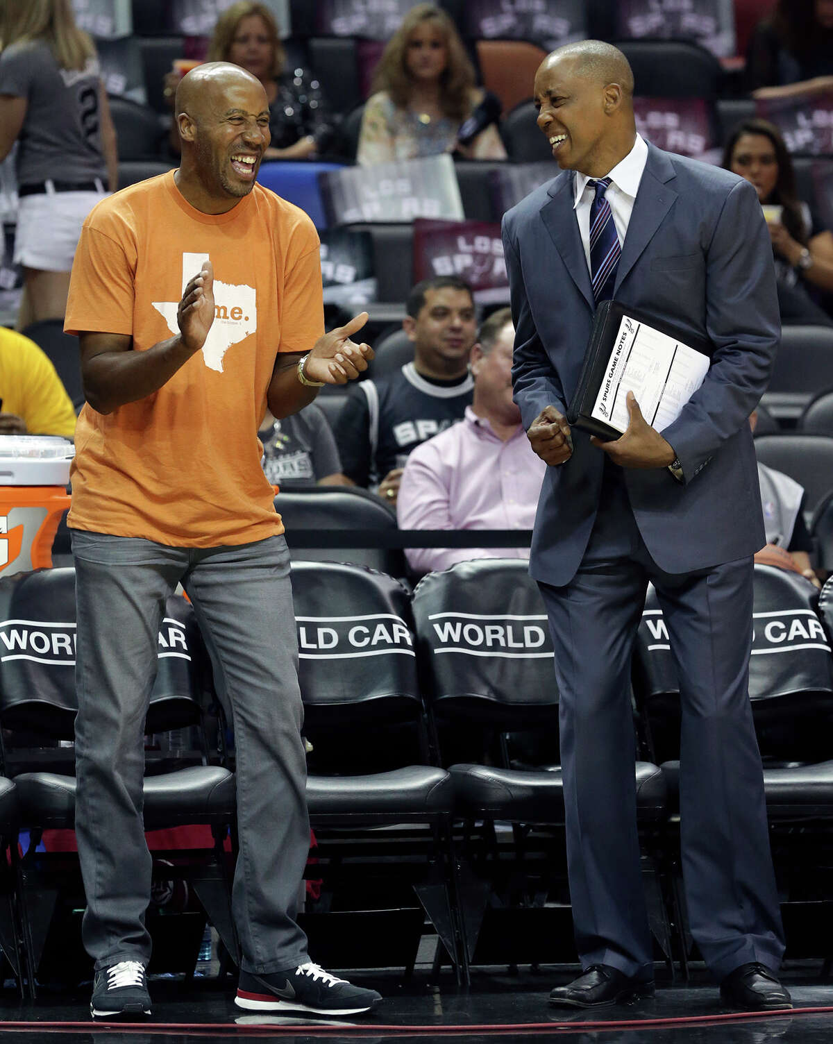 Bruce Bowen and Sean Elliott talk before the Spurs hosted the Denver Nuggets at the AT&T Center on April 3, 2015.