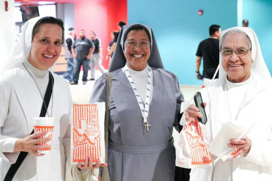 Salesian Sisters Jeanette Palasota (from left), Margaret Natal and Lourdes Trevino of St. John Bosco enjoy the Spurs and Whataburger snacks at the March 2 game against the Detroit Pistons. Photo: Jason Gaines /For The Express-News