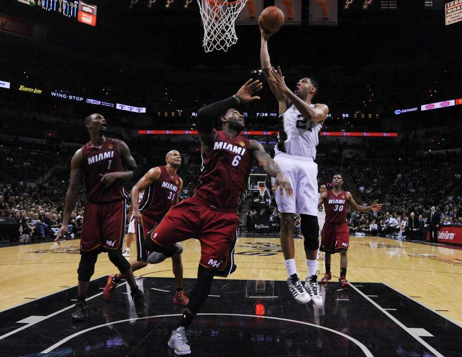 Spurs' Tim Duncan (21) goes up for a shot against Miami Heat's LeBron James in the second half of Game 1 of the 2014 NBA Finals at the AT&T Center on June 5, 2014. Photo: Kin Man Hui /San Antonio Express-News / ©2014 San Antonio Express-News