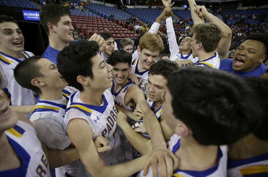 Serra basketball players celebrate after winning the school's first CIF state championship in any sport. Photo: Rich Pedroncelli, AP