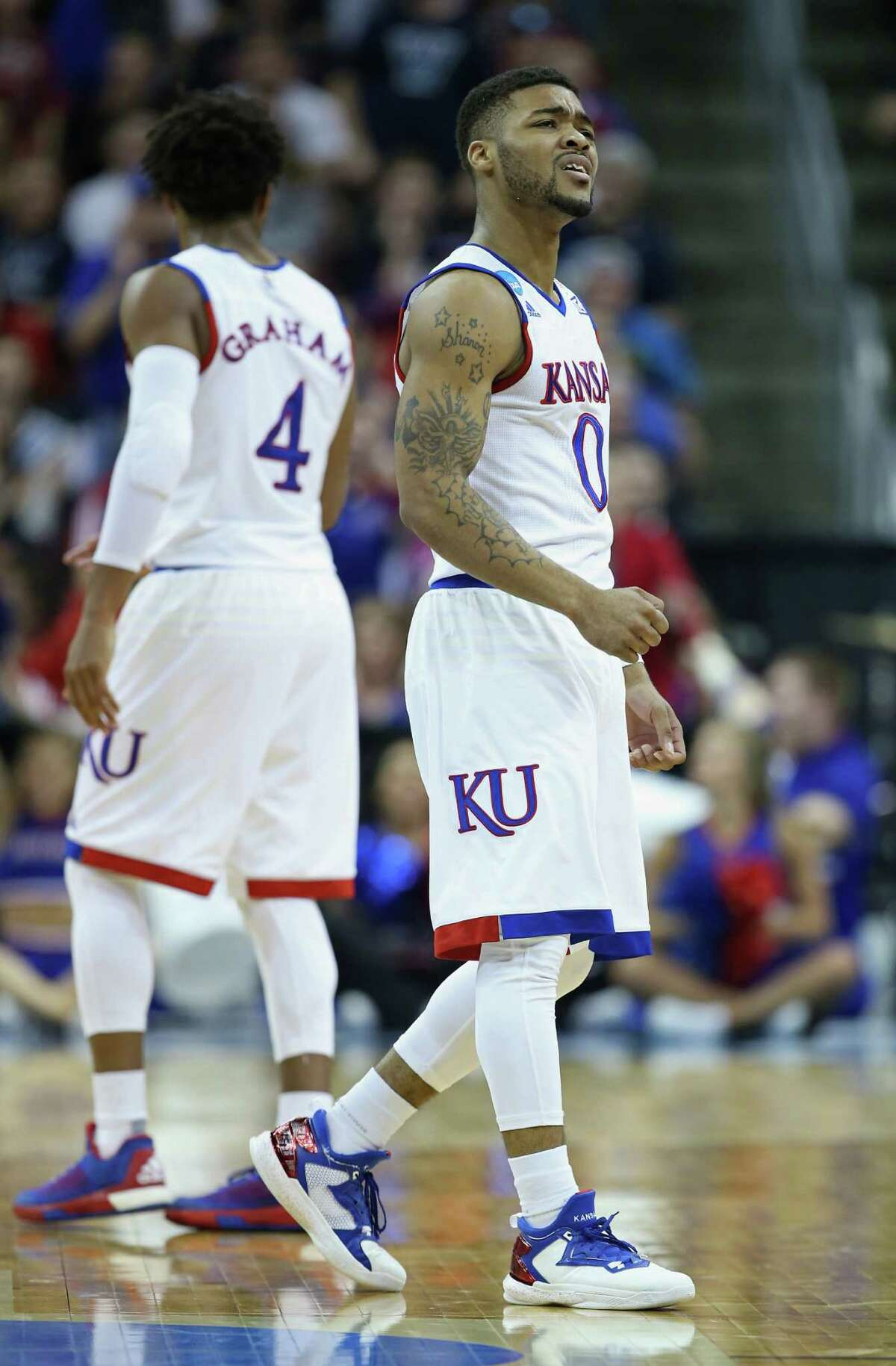 LOUISVILLE, KY - MARCH 26: Frank Mason III #0 of the Kansas Jayhawks reacts in the second half against the Villanova Wildcats during the 2016 NCAA Men's Basketball Tournament South Regional at KFC YUM! Center on March 26, 2016 in Louisville, Kentucky.