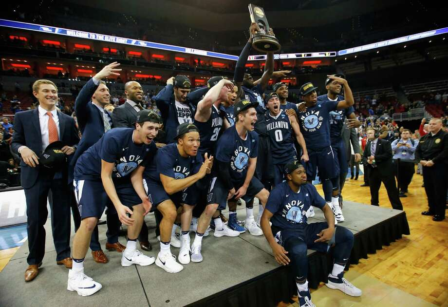 LOUISVILLE, KY - MARCH 26:  The Villanova Wildcats celebrate defeating the Kansas Jayhawks 64-59 during the 2016 NCAA Men's Basketball Tournament South Regional at KFC YUM! Center on March 26, 2016 in Louisville, Kentucky. Photo: Kevin C. Cox, Getty Images / 2016 Getty Images