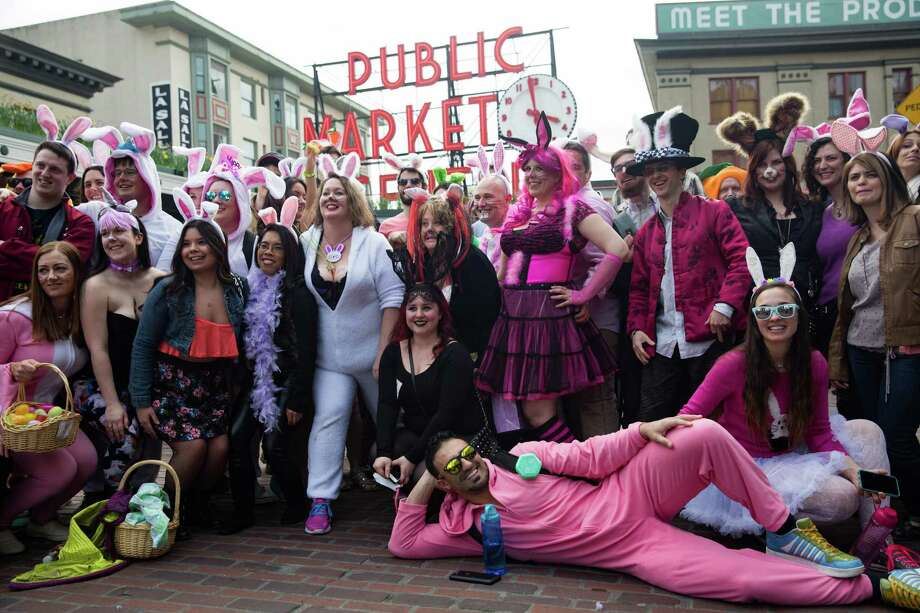 """Bunnies"" pose for a group photo in front of Pike Place during the BunnyCon bar crawl on Saturday, Mar. 26, 2016. Photo: GRANT HINDSLEY, SEATTLEPI.COM / SEATTLEPI.COM"