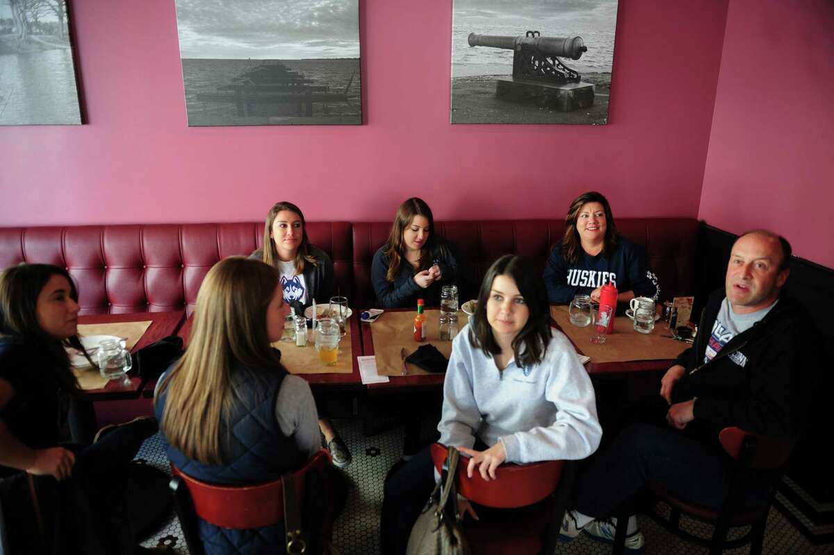 Members of the Eisenberg family and friends eat lunch at the Barnum Publick House in Bridgeport after attending the NCAA Basketball tournament game at the Webster Bank Arena on Saturday. Clockwise from the back row at left are Rachel Eisenberg, Emma Eisenberg, Amy Eisenberg, Mitch Eisenberg, Samantha Eisenberg, Kaitlin Gillard and Stephanie Frazao.