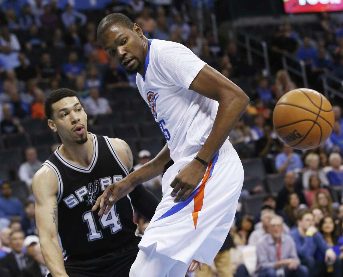 Thunder forward Kevin Durant loses the ball in front of Spurs guard Danny Green in the first quarter in Oklahoma City on March 26, 2016. (