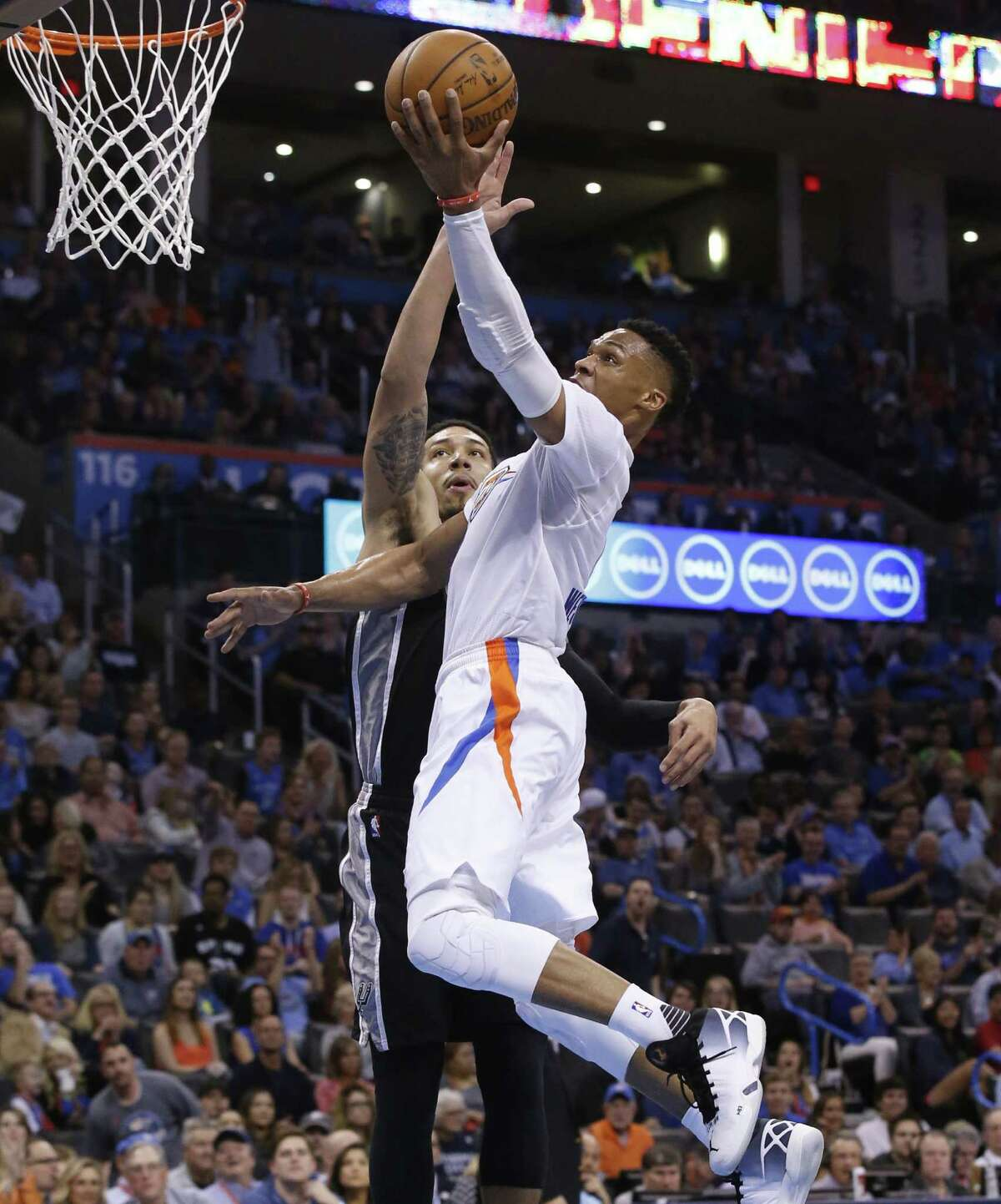 Oklahoma City Thunder guard Russell Westbrook, right, shoots in front of San Antonio Spurs guard Danny Green, left, in the second quarter of an NBA basketball game in Oklahoma City, Saturday, March 26, 2016. (AP Photo/Sue Ogrocki)
