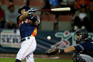 Houston Astros' Jose Altuve bats against the San Diego Padres in a spring training baseball game in Mexico City, Saturday, March 26, 2016.