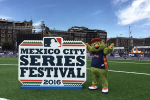 Astros mascot Orbit interacts with fans at Mexico City's Constitutional Plaza, El Zocalo, during a baseball clinic at the Zocalo Baseball Festival hours before the Astros began the two-game Mexico City Series against San Diego at Fray Nano Stadium.