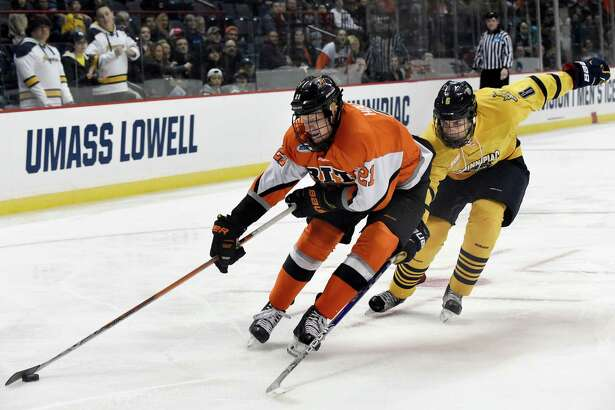 RIT's Micha Holland, left, moves the puck as Quinnipiac's Devon Toews defends during their NCAA first round hockey game on Saturday, March 26, 2016, at Times Union Center in Albany, N.Y. (Cindy Schultz / Times Union)