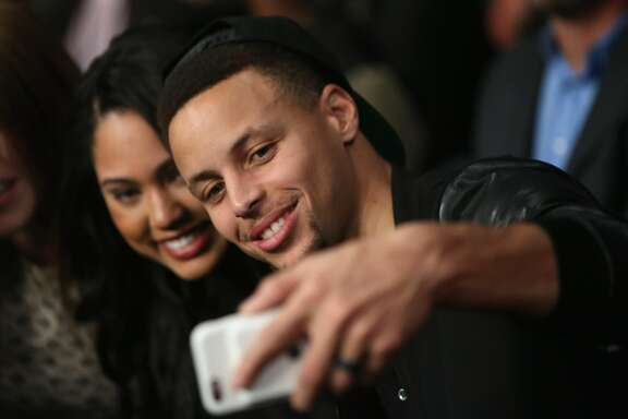 OAKLAND, CA - MARCH 26:  Stephen Curry #30 of the Golden State Warriors and his wife Ayesha attend the Andre Ward fight against Sullivan Barrera in their IBF Light Heavyweight bout at ORACLE Arena on March 26, 2016 in Oakland, California.  (Photo by Ezra Shaw/Getty Images)