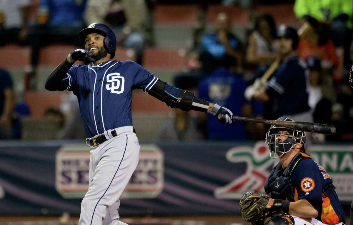 San Diego Padres' Alexei Ramirez, left, bats against the Houston Astros in a spring training baseball game against the Houston Astros in Mexico City, Saturday, March 26, 2016.