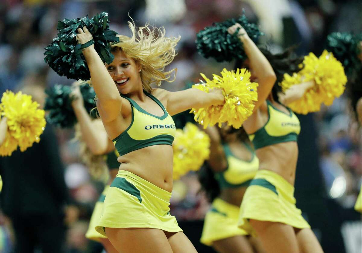 Oregon cheerleaders perform during the first half of an NCAA college basketball game against Oklahoma in the regional finals of the NCAA Tournament, Saturday, March 26, 2016, in Anaheim, Calif.