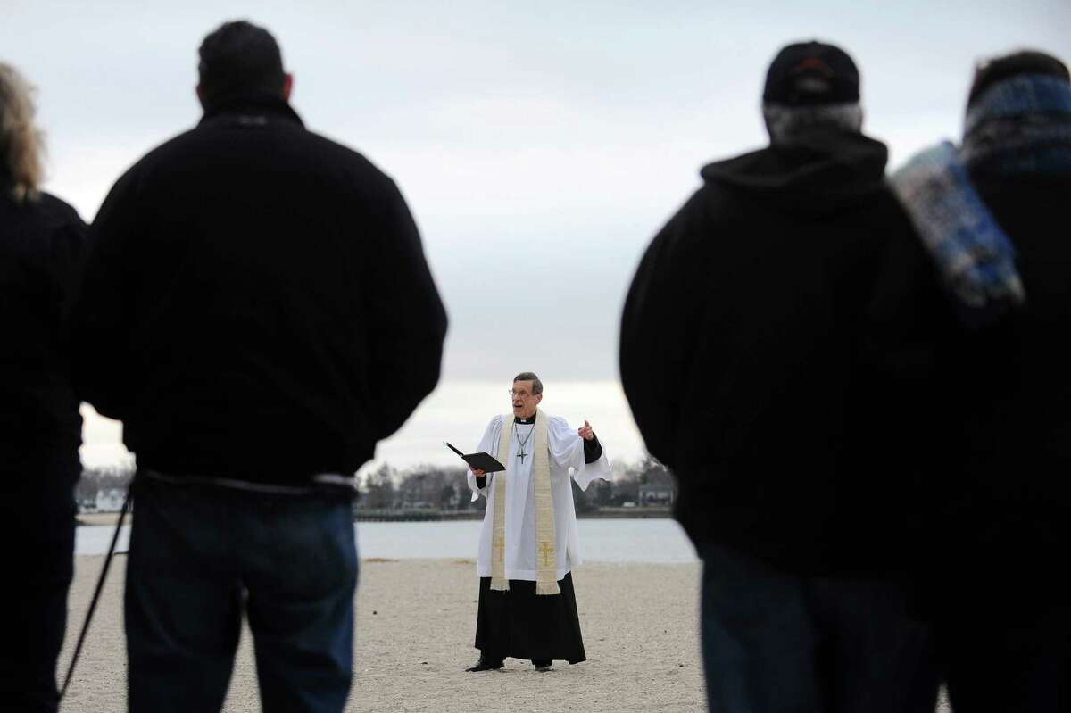Pastor Jack Breznen, of Stamford's Trinity Lutheran Church, gives the annual sunrise sermon on Easter Sunday at the East Pavilion of Cove Island Beach in Stamford, Conn. on Sunday morning, March 27, 2016.