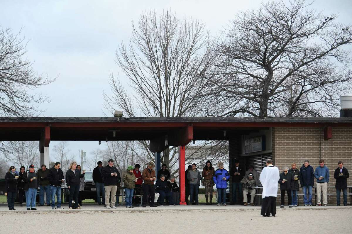 Pastor Jack Breznen, of Stamford's Trinity Lutheran Church, gives the annual sunrise sermon for more than 30 people on Easter Sunday at the East Pavilion of Cove Island Beach in Stamford, Conn. on Sunday morning, March 27, 2016.
