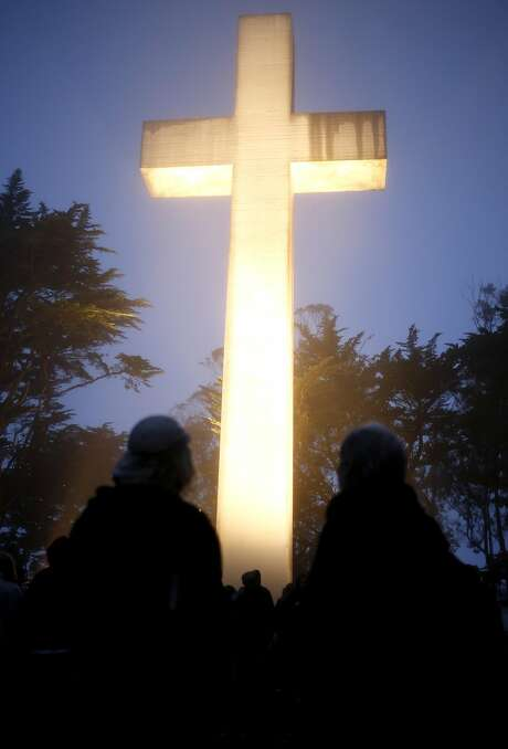 People gather before Easter sunrise service at the Mount Davidson Cross in San Francisco. Photo: Connor Radnovich, The Chronicle