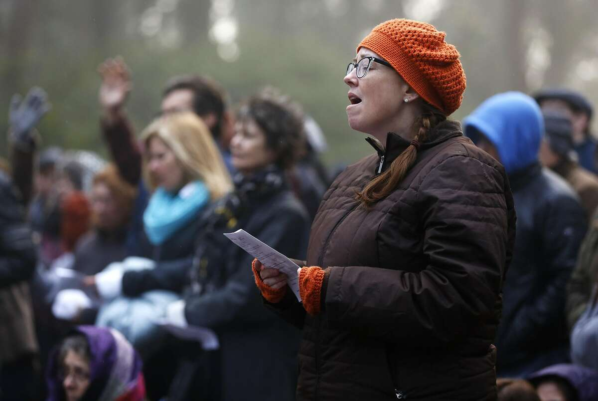 Lisa Hoff sings along during Easter sunrise service at the Mount Davidson Cross in San Francisco, California, on Sunday, March 27, 2016.
