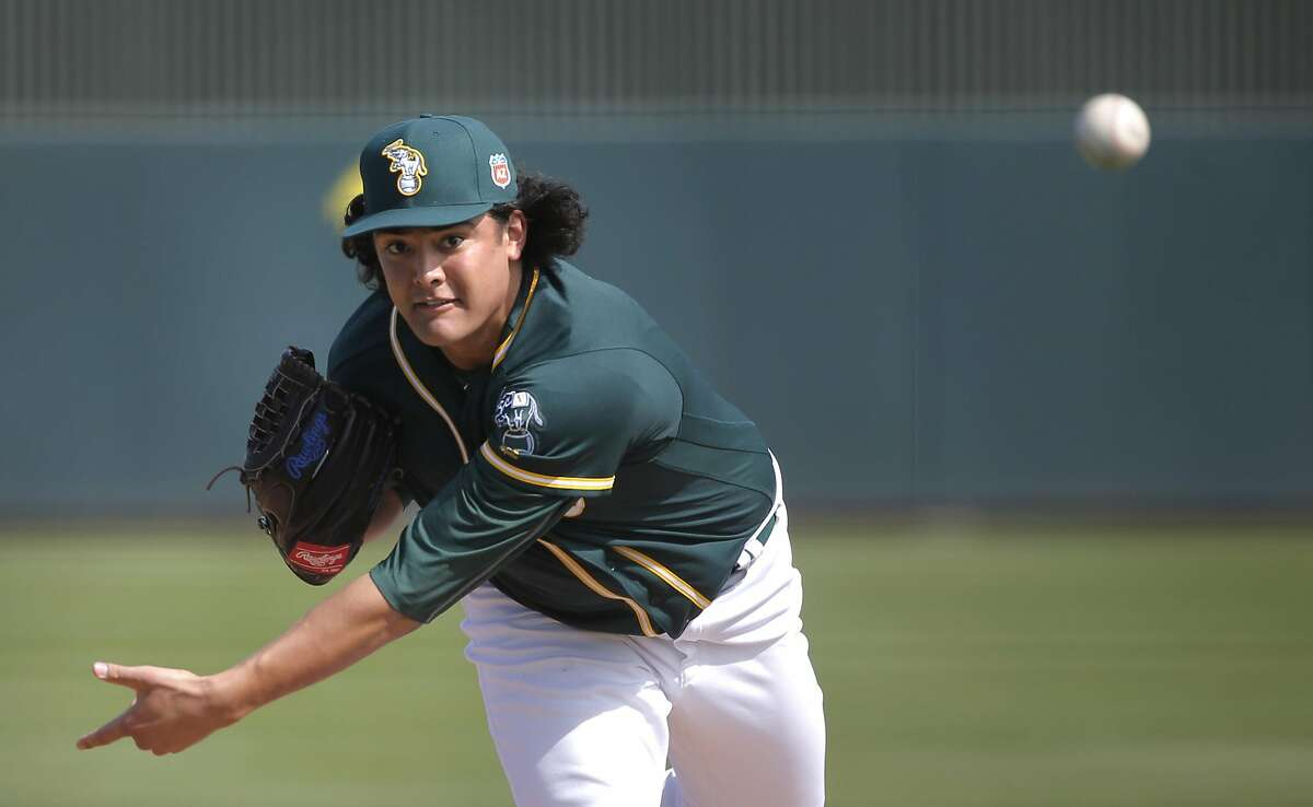 Sean Manaea throws during an intra-squad game at the Oakland Athletics spring training workouts in February in Mesa, Ariz.