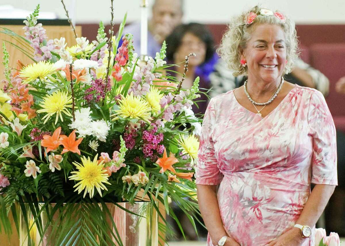 Parishioner Sarah Goodspeed of Danbury poses with the Easter arrangement on the stage of New Hope Baptist Church in Danbury prior to the Easter Sunday service. Sunday, March 27, 2016