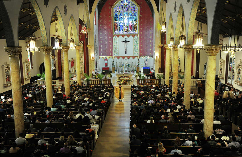 Father Frank Gomez speaks to a packed house in both Spanish and English during the 12:30 Easter service at St. Charles Borromeo Catholic Church on East Main Street in Bridgeport, Conn. on Sunday, March 27, 2016.