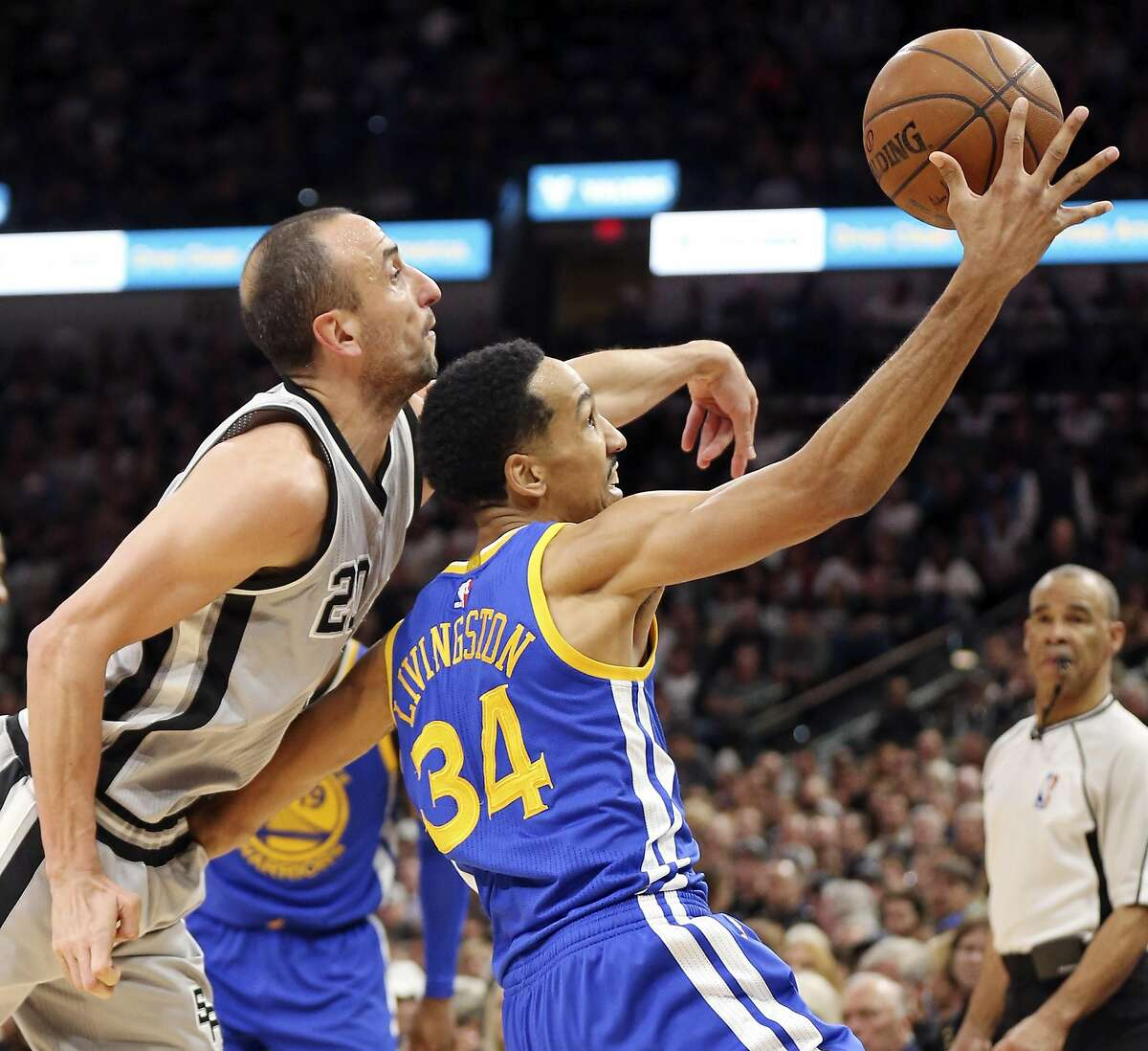 San Antonio Spurs' Manu Ginobili and Golden State Warriors' Shaun Livingston struggle for control of the ball during second half action Saturday March 19, 2016 at the AT&T Center. Ginobili was called for a foul on the play. The Spurs won 87-79.