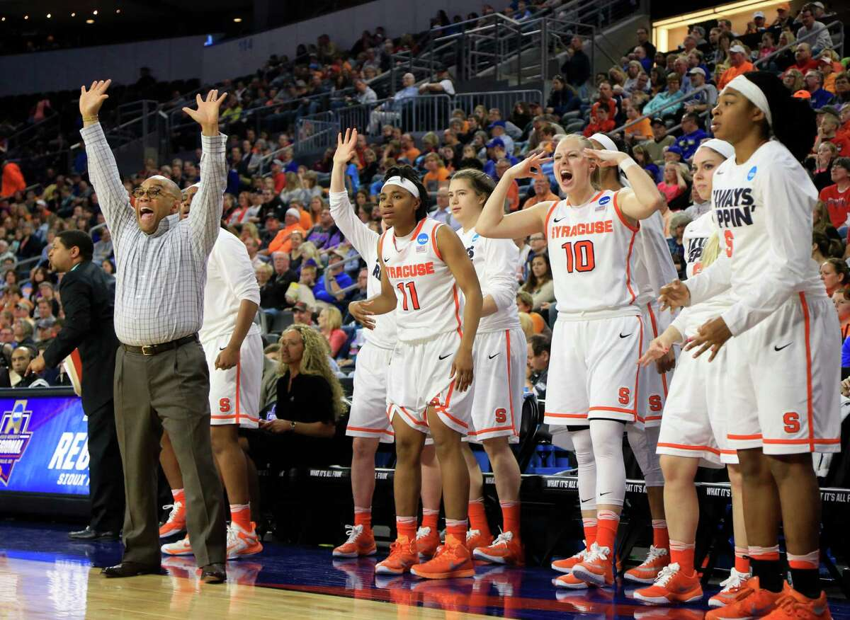 Syracuse coach Quentin Hillsman, left, and his bench react to a play during a women's college basketball regional final against Tennessee in the NCAA Tournament in Sioux Falls, S.D., Sunday, March 27, 2016. Syracuse won 89-67.