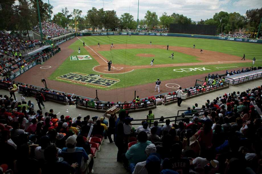 Fans watch a spring training baseball game between the San Diego Padres and the Houston Astros in Mexico City, Sunday, March 27, 2016. Photo: Eduardo Verdugo, AP / AP