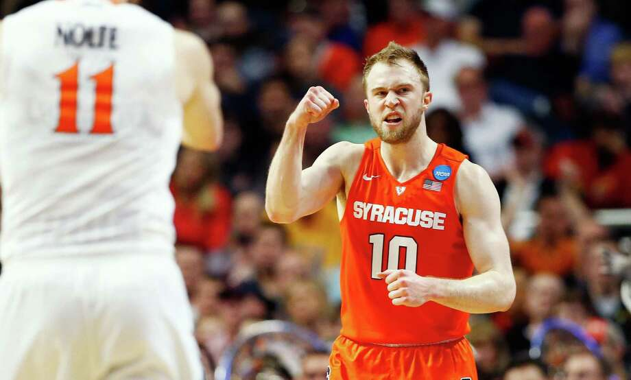 CHICAGO, IL - MARCH 27:  Tyler Lydon #20 of the Syracuse Orange celebrates in the second half against the Virginia Cavaliers during the 2016 NCAA Men's Basketball Tournament Midwest Regional Final at United Center on March 27, 2016 in Chicago, Illinois. Photo: Jamie Squire, Getty Images / 2016 Getty Images
